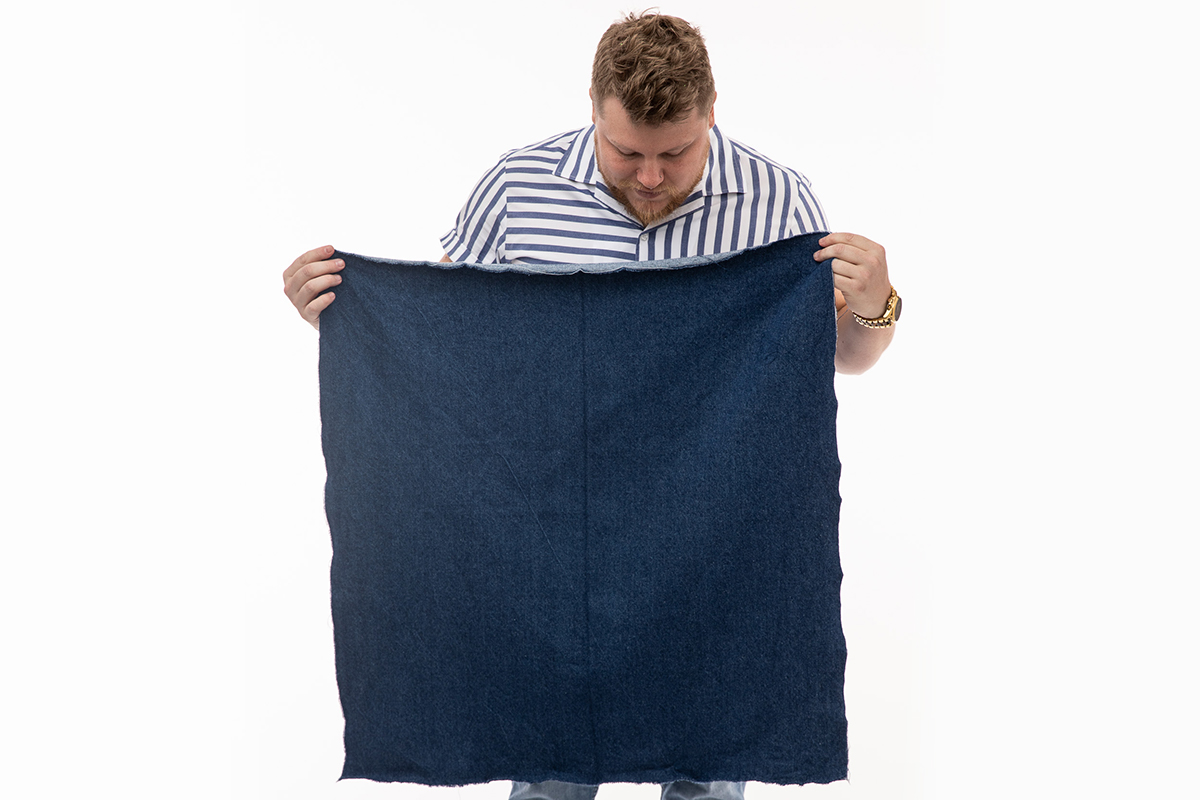 Picture of Brad holding fabric