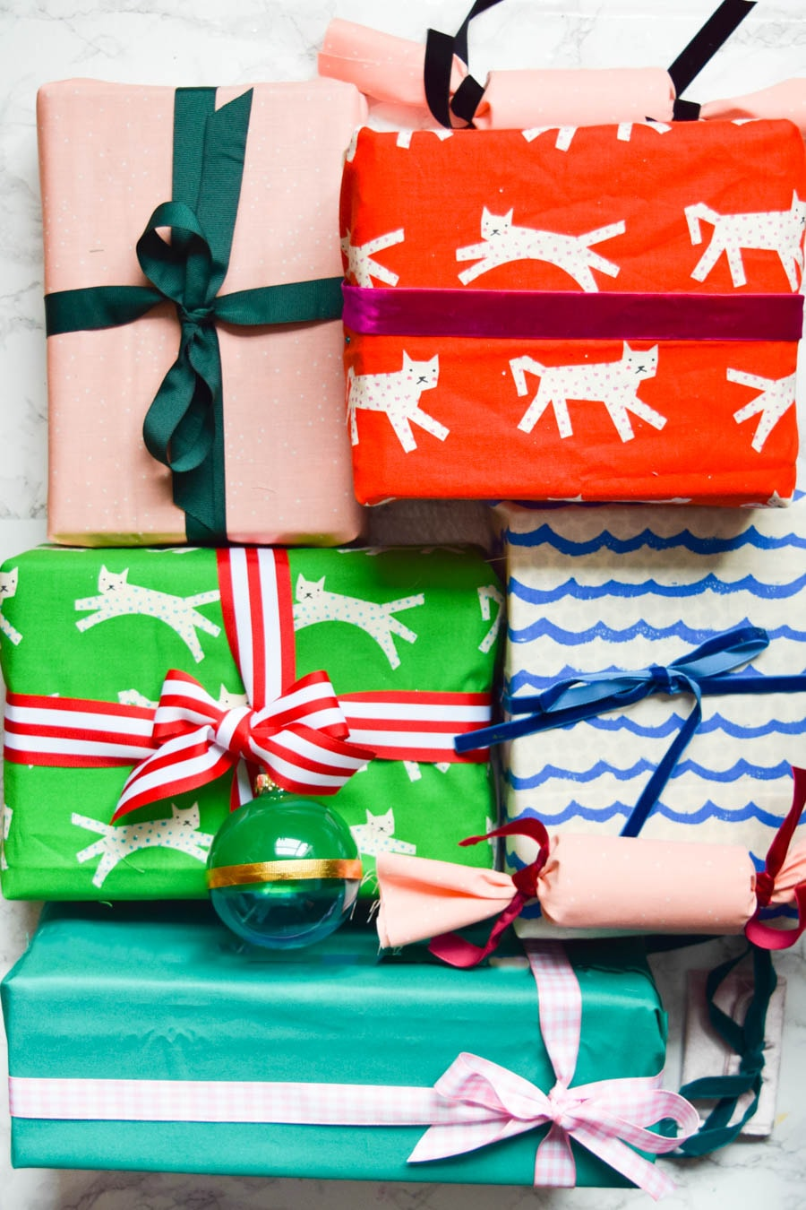 3 Ways To Wrap Gifts In Fabric Learn 3 Easy Ways To Wrap Gifts In Fabric That Require No Sewing Use Holiday Fabric For Festive Gift Wrapping Or Utilize These Techniques