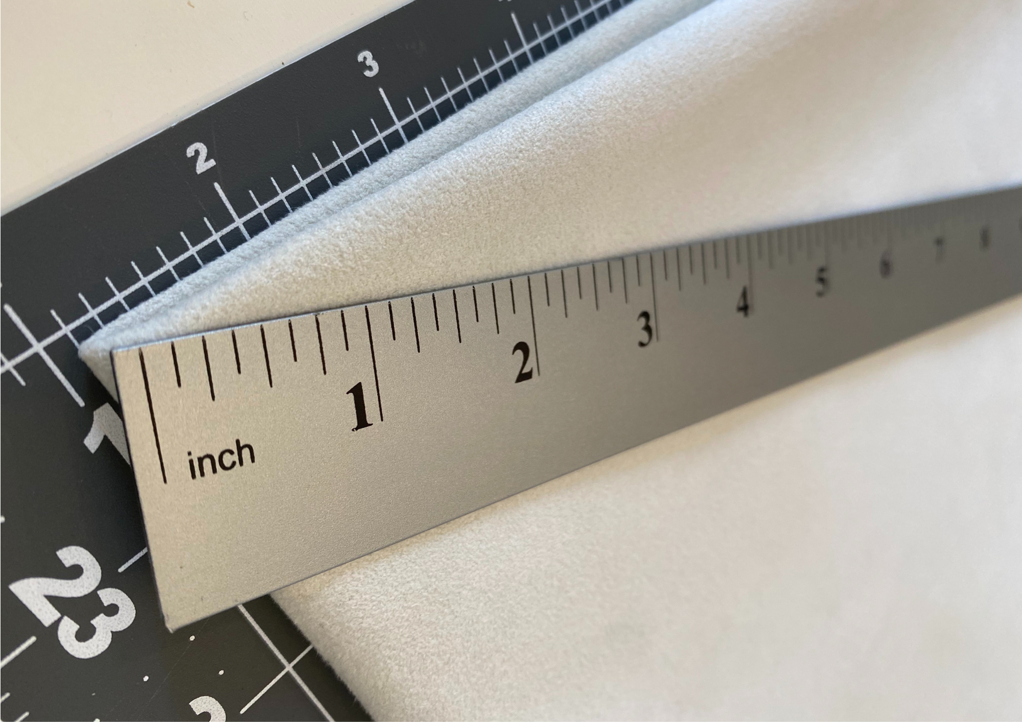 folded fabric with yardstick on top