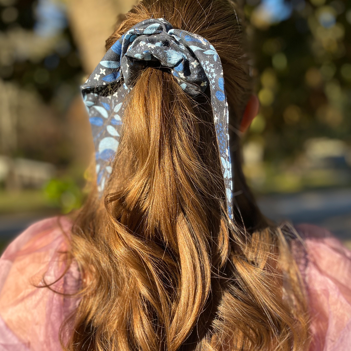 finished scrunchie in girl's hair